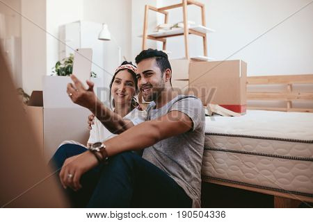 Couple Moving In New Home And Taking Selfie