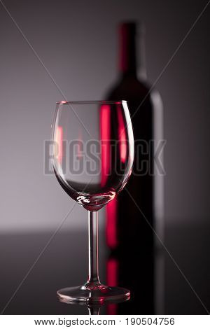 Glass of red wine on glass table.