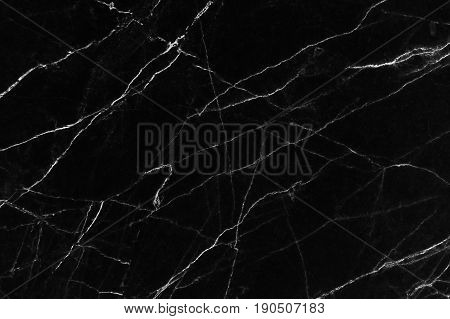 Black marble texture with lots of contrasting veining (Natural pattern for backdrop or background, Can also be used create surface effect to architectural slab, ceramic floor and wall tiles)