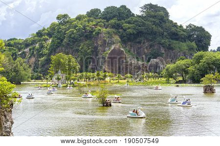 Dong Nai, Vietnam - June 4th, 2017: The lovers relaxing on a swan boat on lake on sunny spring morning, boat trip on the lake floating distance romantic air to welcome spring in Dong Nai, Vietnam