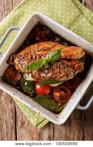 Delicious Chicken Fillet Baked With Caprese Close-up In A Baking Dish. Vertical Top View