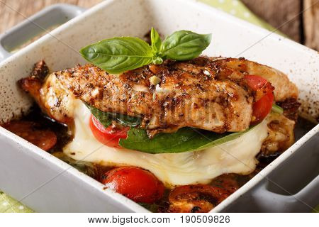 Delicious Chicken Fillet Baked With Caprese Close-up In A Baking Dish. Horizontal