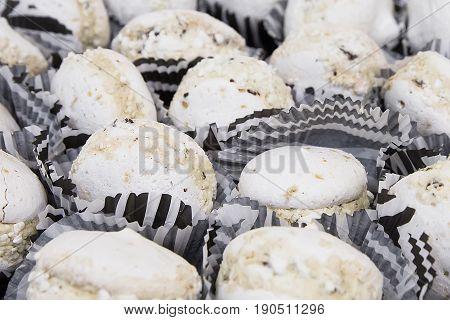 Tasty White Macaroons On Table