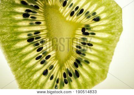 slice of kiwi fruit close up photo of kiwi fruit
