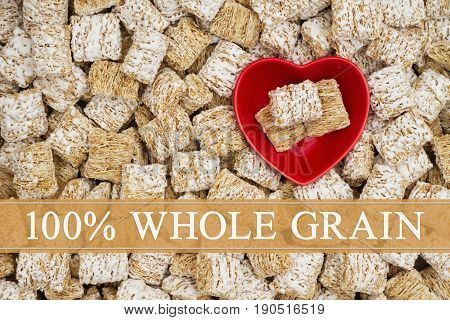 100% Whole Grain text over whole grain wheat cereal with a red heart shaped bowl