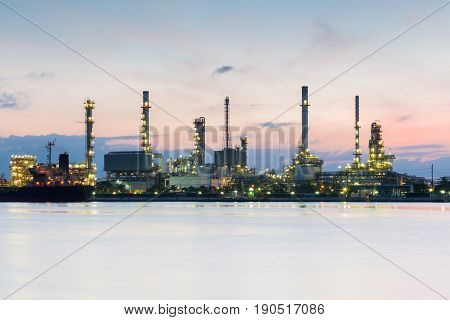 River front over Oil refinery with sunrise sky industrial landscape background