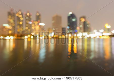Blurred bokeh light office building and reflection abstract background