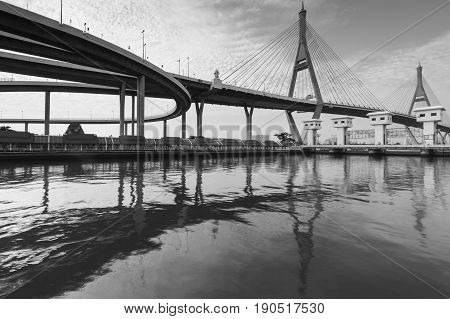Black and White Suspension bridge over refection on the river Bangkok Thailand landmark