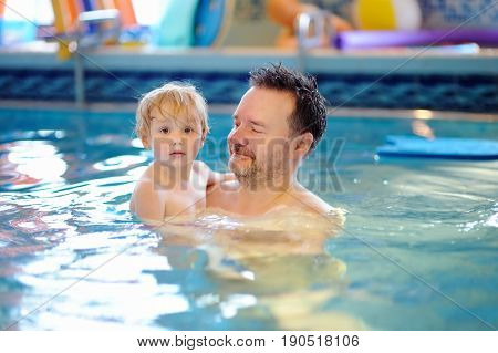 Happy Smiling Little Boy With His Father In Swimming Pool