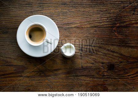 Cup of Coffee with milk on Wooden Table
