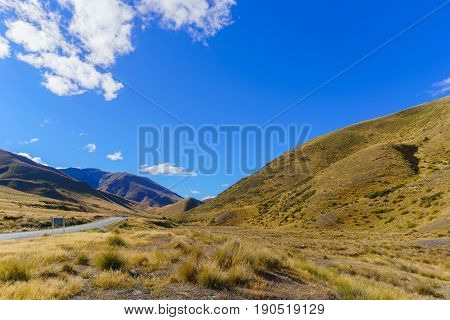 Lindis Pass Scenic Reserve is the highest point on the South Island's state highway network of New Zealand offering mountain and tussock grassland scenery