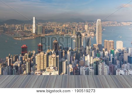 Opening wooden floor Hong Kong city downtown from the Peak mountain point of view cityscape downtown background
