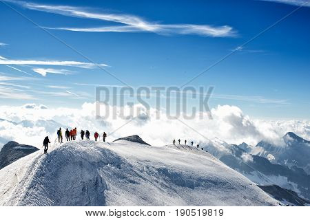 climbers climbing the mountain with mountain equipment high mountain activity