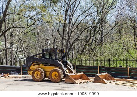 Front End Loader at Silt Fence on construction site