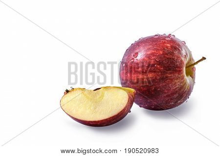Fresh red apple (Malus domestica Malus pumila or Pyrus malus) with drops of water and a quarter of fresh apple with seeds isolated on white background