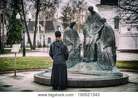 Orthodox Priest At The Sculpture