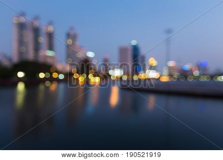 Night blurred bokeh office building and reflection at twilight abstract background