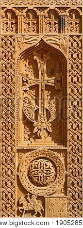 The cross-stone. Christian cross. Carved Armenian historical ornament. Stone carving of the Tuff.