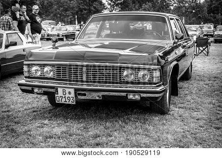 PAAREN IM GLIEN GERMANY - JUNE 03 2017: Soviet full-size luxury car GAZ-14 Chaika. Black and white. Exhibition