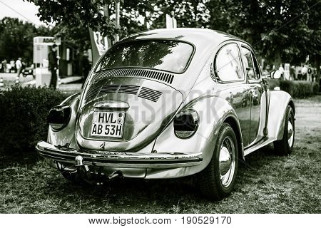 PAAREN IM GLIEN GERMANY - JUNE 03 2017: Economy car Volkswagen Beetle 1973. Stylization. Toning. Rear view. Exhibition