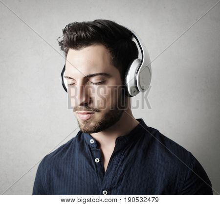Relaxed man wearing white headphones