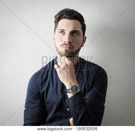 Handsome man thinking