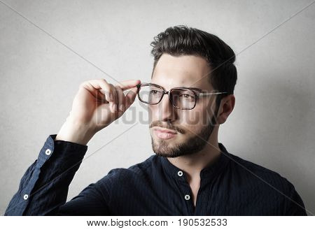 Young businessman wearing glasses looking away