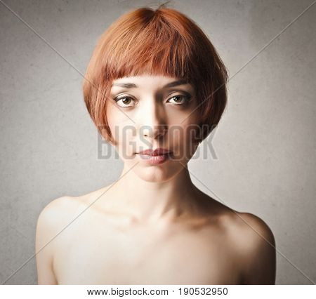 Portrait of young woman with bob cut