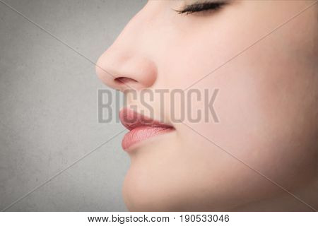 Young woman's profile with soft pink skin and beautiful lips
