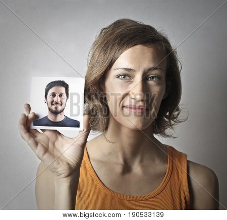 Woman showing the portrait of a man