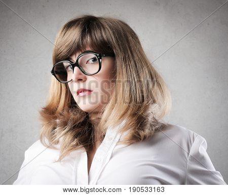 Smart girl wearing glasses with a severe look