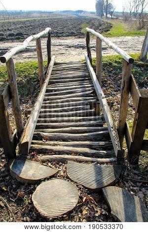 Small wooden footbridge across a small stream