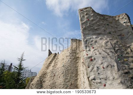Outdoor artificial climbing wall in a public park
