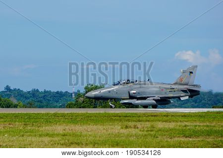 Labuan,Malaysia-June 9,2017:View of the Royal Malaysian Air Force BAE Hawk 208 fighter jet in Labuan airport,Malaysia.On 2013,the Hawk 208 was used in air strikes against the Filipino insurgents.
