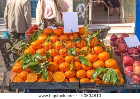 Fresh oranges on a street cart market in Athens, Greece.Concept for travel, urban and street life, fresh, healthy, raw, easy accessible food and small family business