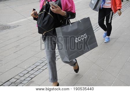Copenhagen /Denmark - 10 June 2017. Asian consumers purchaes dish brand ecco products and with shopping bags (Photo.Francis Joseph Dean/Deanpictures)