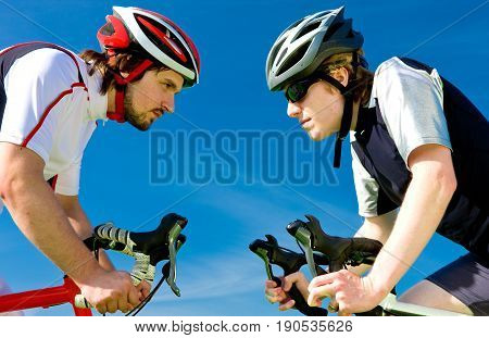 Two cyclists facing each other, getting ready to race
