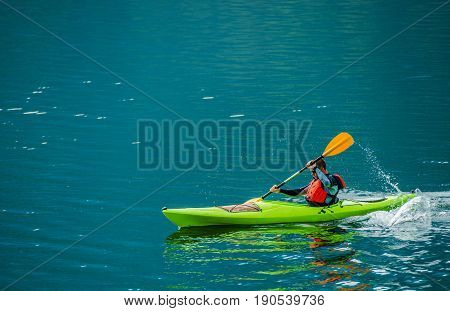 Caucasian Kayaker on the Lake. Kayak Trip on the Scenic Lagoon.