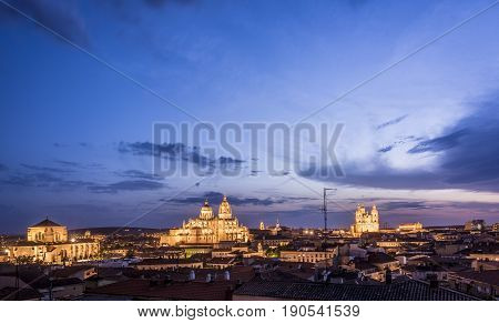 Night view of Salamanca cityscape, with the Cathedral, the Pontifical University and Dominican monastery of San Esteban fully illuminated. The Old city of Salamanca is declared by UNESCO a World Heritage Site.