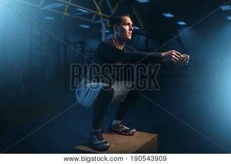 Athlete on training, endurance exercise with box