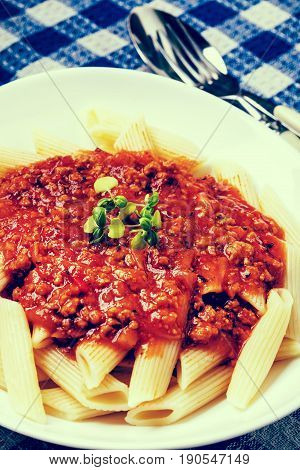 Pasta Penne With Tomato Bolognese Sauce. Instagram Style Filtred Image.