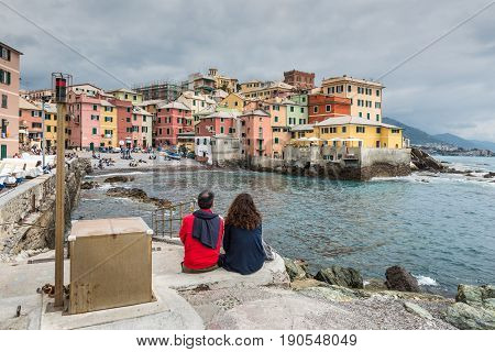Genoa Italy - May 14 2017: Couple looking at the ancient fishing village on the sea in Genoa Boccadasse Italy.