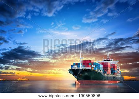 Logistics and transportation of International Container Cargo ship in the ocean at twilight sky Freight Transportation Shipping