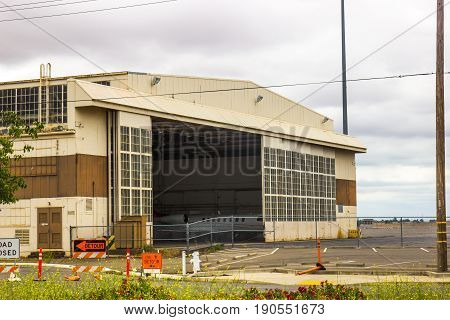 Large Airplane Hangar Doors On Cloudy Day