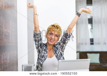 Young Woman Smiling With Outstretched Arms