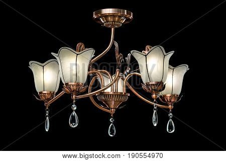 Classic old Chandelier isolated on black background. Chandelier lamp for the living room interior.