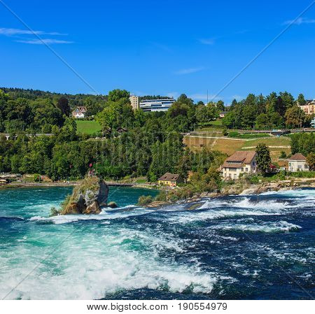 Laufen, Switzerland - 29 August, 2015: the Rhine Falls. The Rhine Falls is the largest plain waterfall in Europe, located on the border between the Swiss cantons of Schaffhausen and Zurich in northern Switzerland.