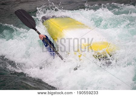 Over Turned Kayak In Rough Water