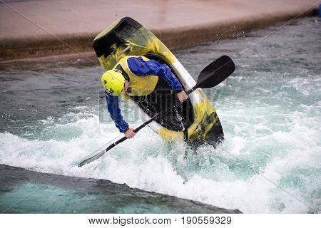 Man Vertical Upright Ina  Play Boat Kayak