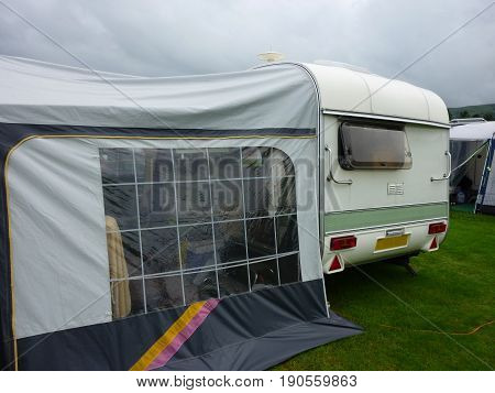 Mobile Caravan On Campsite With An Awning Up